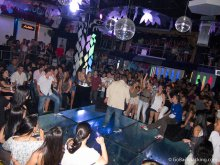 A singer performs inside Prizma, a popular reggaeton club in Medellin.