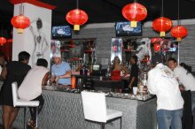 Patrons hang out at the main bar inside Zen Exotic Lounge and Club in downtown Orlando.